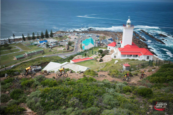 Riders pass above Blaise Lighthouse during the 13km urban-assault style prologue on the opening stage of the 2015 Cape Pioneer Trek in Mossel Bay, South Africa on Sunday. Photo credit: Zoon Cronje/Nikon