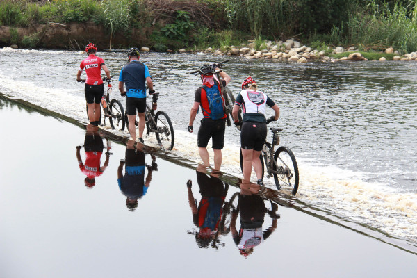 Riders making their way across one of the river crossings on Day 1