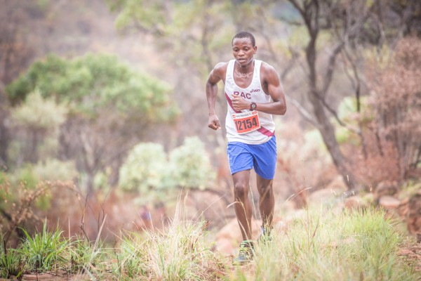 Just over 600 trail running enthusiasts gathered at the Buffelspoort Dam in the North West Province on Sunday, 24 January 2016 to participate in the first PUMA Trail Run of the season.  Making his PUMA Trail Run debut, Tranquil Gumbo set the course on fire in the men's 12km PUMA Trail Run claiming victory in a lightning fast time of 47 minutes 03 seconds.  Seen here:  Tranquil Gumbo in action on the day.  PHOTO CREDIT:  Tobias Ginsberg