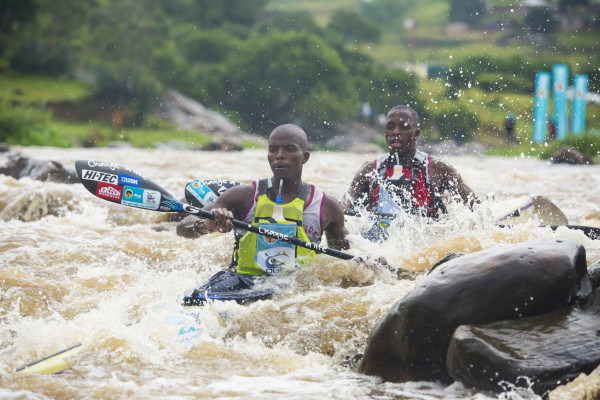Computershare Change a Life Academy members Mmeli Cele (front) and Khumbulani Nzimande (back) put in the setup's performance of the 2016 FNB Dusi Canoe Marathon as they powered their way to tenth place overall, Nzimande's maiden gold medal. Anthony Grote/ Gameplan Media