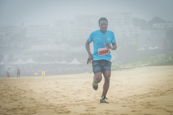 Kings Beach was host to Nelson Mandela Bay's very first PUMA Trail Run on Sunday, 31 January 2016.  Myuyisi Gcogco was the trail runner to beat in the men's race, completing the 10.2km PUMA Trail Run in an impressive time of 38 minutes 27 seconds.  Seen here:  Myuyisi Gcogco in action on the day.  Photo Credit:  Tobias Ginsberg