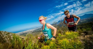 "Stillwater Sports is excited to welcome Cell C, one of South Africa's leading mobile providers, as the title sponsor of South Africa's premier three day stage trail run, the Cell C AfricanX Trailrun presented by ASICS.  Seen here (from left to right):  Sister and brother duo Natia and Antoine van Heerden of Team ""Twinning"" in action during the 2015 AfricanX Trailrun.  Photo Credit:  Tobias Ginsberg"