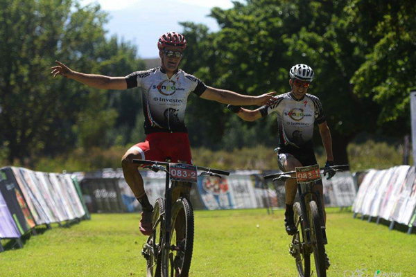 New Zealander Sam Gaze (left) and his Investec-Songo-Specialized teammate, Christoph Sauser celebrate their victory on Stage 2 of the DUTOIT Tankwa Trek international mountain bike stage race in South Africa on Saturday. Photo credit: www.zooncronje.com
