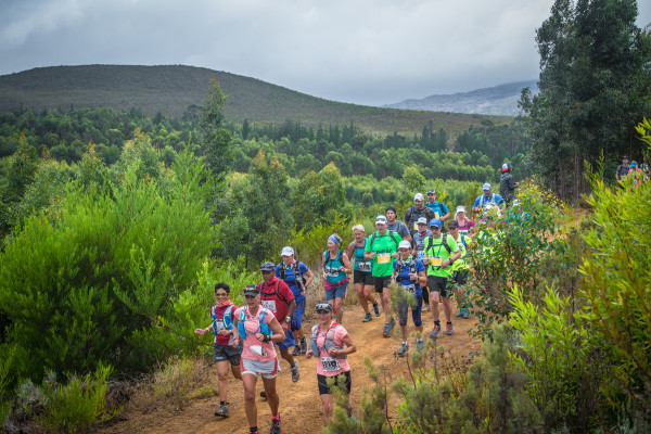 Entries are open for South Africa's premier three day stage trail run, the Cell C AfricanX Trailrun presented by ASICS.  Taking place the weekend of 17 – 19 March 2017, teams of two trail running enthusiasts (male/female/mixed) will be seen battling it out on a route varying in distance between 22km - 34km each day.  Entries are open, but are LIMITED to 350 teams.  An early bird entry fee will apply to the first 100 teams that enter.  Seen here:  Trail running enthusiasts in action during the 2016 Cell C AfricanX Trailrun presented by ASICS.  Photo Credit:  Tobias Ginsberg