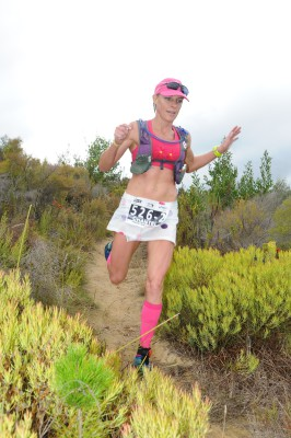 Well-known South African trail runner, Chantel Nienaber will be seen enjoying the trails in Kleinmond on Sunday, 24 April 2016 at the much anticipated Cell C Arabella Trail Run Challenge.  Seen here:  Chantel Nienaber in action at the 2016 Cell C AfricanX Trailrun presented by ASICS.  Photo Credit:  Jetline Action Photo