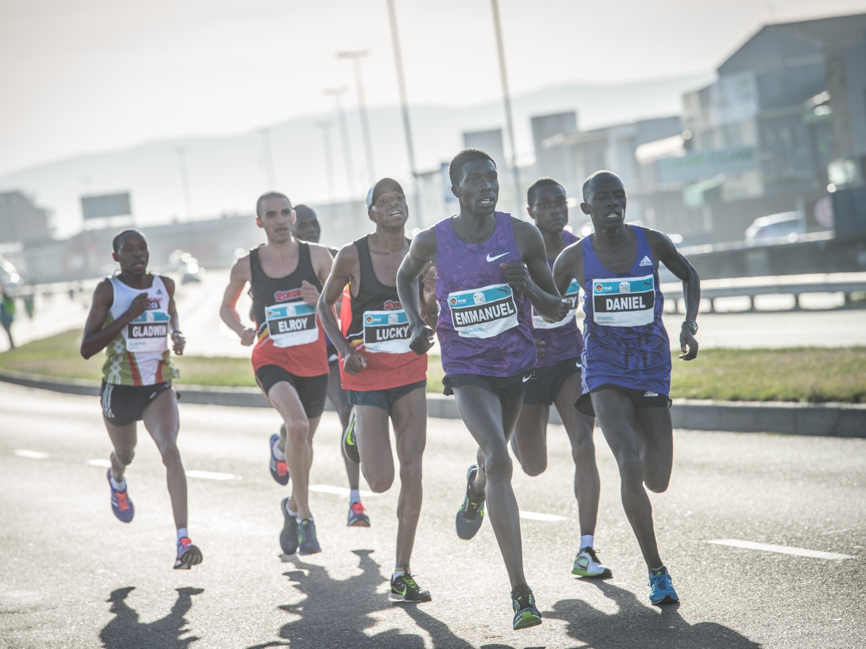 Not only will Stephen Mokoka and Elroy Gelant take the challenge to the defending Champion Emmanuel Bett, runner up Daniel Salel and third placed Timothy Toroitich, but they will have ample support from the likes of Gladwin Mzazi, Joel Mmone and Mariano Eesou at this year's FNB Cape Town 12 ONERUN.  Seen here:  The elite men's field in action during the inaugural event in 2015.  In the mix was Gladwin Mzazi, Elroy Gelant, Emmanuel Bett, Daniel Salel and Timothy Toroitich.   Photo Credit:  Tobias Ginsberg