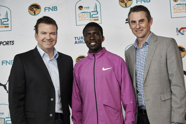 The second annual FNB Cape Town 12 ONERUN will take place this coming Sunday, 15 May 2016.  It is South Africa versus Kenya, Gelant versus Mokoka and Van Zyl vs the Phalula's in the men's and women's race respectively.  Seen here (from left to right):  Stephan Claassen, Provincial Head FNB Business Western Cape, with defending men's champion Emmanuel Bett (Kenya) and Michael Meyer, Managing Director of Stillwater Sports.  Photo Credit:  Shawn Benjamin