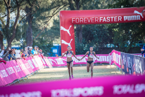 Lebo and Lebogang Phalula in action at the Totalsports Women's Race in Durban in 2015.  Photo Credit:  Tobias Ginsberg