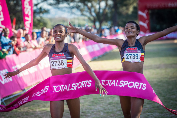 PUMA ambassadors, Lebo and Lebogang Phalula and Yolande Maclean will join thousands of runners on the start line of the much anticipated Totalsports Women's Race in Durban on Sunday, 17 July 2016.  Seen here (from left to right):  Lebo and Lebogang Phalula claiming gold at the Totalsports Women's Race in Durban in 2015.  Photo Credit:  Tobias Ginsberg