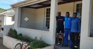 "The organizers of the Cape's most loved three-day stage mountain bike event, the FNB Wines2Whales (W2W) Mountain Bike (MTB) Events, have recently purchased property in Grabouw for Cape Trails, the official route builders of the FNB W2W MTB Events.  According to Johan Kriegler, FNB W2W MTB Director, purchasing a house for Cape Trails has been a goal for over four years.  ""The house is situated in the town of Grabouw.  It is near all the major shops and is in a safer location.  It's a double plot with a two bedroom house and a one bedroom flat on it.  Ashwell Swartz has moved into the house, while Denzel Scheepers has moved into the flat.  We plan to build two more dwellings on the second plot for remaining CapeTrails members, Jason Adams and Brendon Booysen.""  Seen here (from left to right):  Denzel Scheepers, Brendon Booysen and Ashwell Swartz of Cape Trails in front of their new home."
