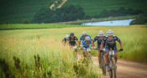 Known by many mountain bikers for their water point activations and marshal support at the FNB Wines2Whales (W2W) Mountain Bike (MTB) Events, the Elgin Round Table is a proud supporter of numerous charities within the Elgin/Grabouw area including two Old Age Homes, the ACVV Dienssentrum Meals On Wheels Project, Speelland Pre-School and Elgin Drummies to name just a few.  Through its involvement with the FNB W2W MTB Events, the Elgin Round Table is able to generate funds that can be utilized towards worthwhile projects such as the ACVV Dienssentrum Meals On Wheels Project.  Seen here:  James Reid and Erik Kleinhans in the lead during Stage Two of the 2015 FNB Wines2Whales MTB Race.  Photo Credit:  Tobias Ginsberg