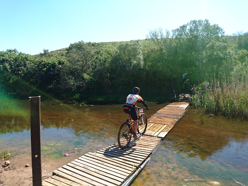 The floating bridge over the Kat River kept riders and their bikes mercifully out of the mud. Photo by Seamus Allardice.