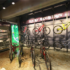 Intelligent use of vertical wall space, black backdrop and appropriate lighting ensure the Rocky Mountain bikes on sale at THIS WAY OUT, Cape Town are well displayed.
