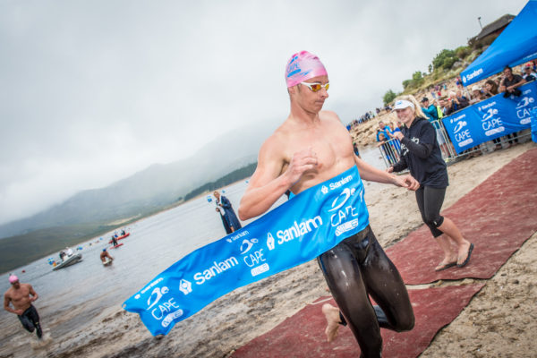 Entries for the Western Cape's most exciting open water swim, the Sanlam Cape Mile, will open on Saturday, 01 October 2016.  Returning to the majestic Eikenhof Dam at the Grabouw Country Club on Sunday, 19 February 2017 entrants can choose between an exhilarating 1 mile (1.6km) and a refreshing 500m swim.  Seen here:  Myles Brown pipping Chad Ho and Danie Marais to the finish of the 2016 Sanlam Cape Mile.  Photo Credit:  Tobias Ginsberg