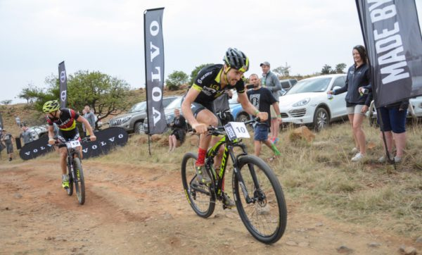 Gert Heyns overtakes Konny Looser to grab the men's race at the Volvo Summit on Spioenkop, a race within a race at the 2016 Grindrod Bank Berg & Bush event in KwaZulu-Natal. Looser looks back to make sure his second place is secure. Heyns reached the top in a time of four minutes 35 seconds, a new record for the two-year-old sprint race.