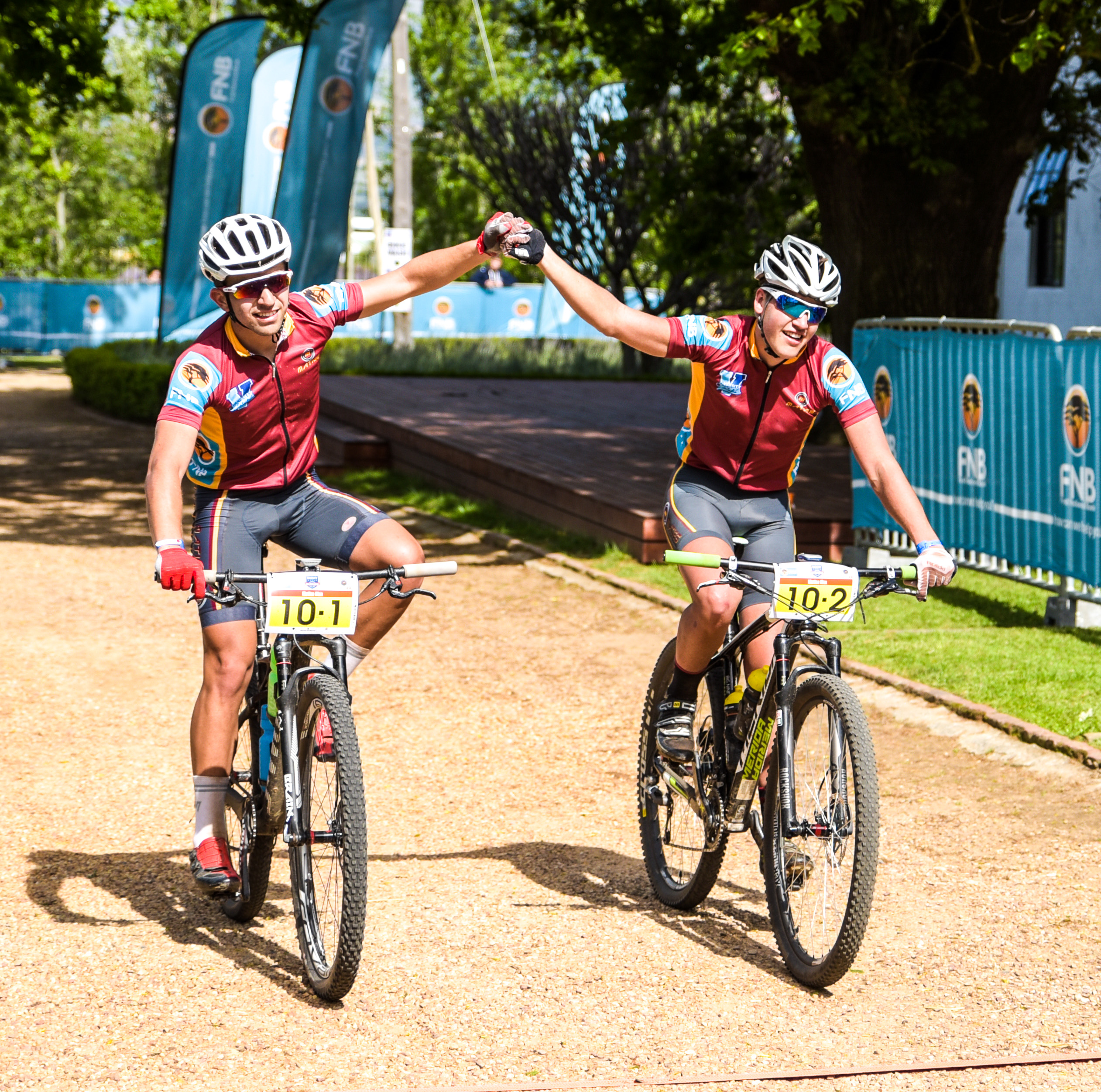 Maties' Varsity Sports MTB Challenge winners, CP van Wyk and Ian Lategan crossing the finishing line on day two of the Varsity Sports MTB Challenge. Please credit Robert Ward for this photo.