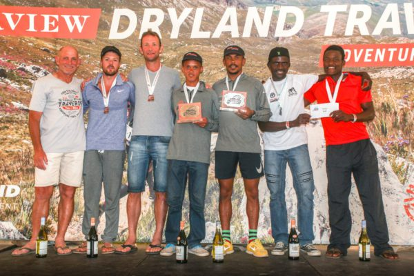 7.The men's team general classification podium. From left to right: Donald Mouton (Fairview Wine and Cheese), Warren Dickson & Jade Muller (3rd Wolf Pack 1), Francois Maquassa & John April (1st Team 1) and Obey Mtetwa & Mvuyisi Gcogco (2nd Raidlight/Free Spirit).