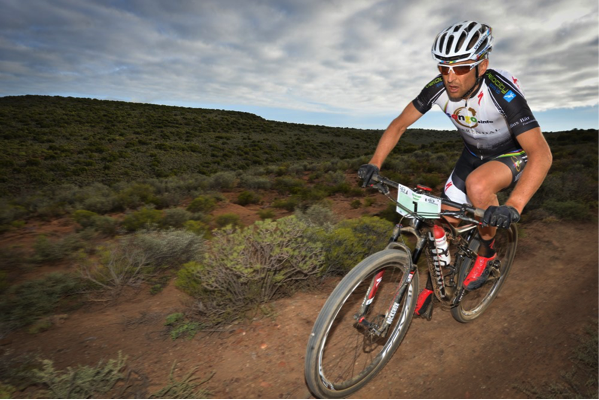 Two-time winner, Christoph Sauser, pictured here on his way to second place in 2014, will be using Saturday's Fairview Attakwas Extreme MTB Challenge as his first major preparation race in his quest for a sixth Cape Epic title. Photo credit: www.zcmc.co.za
