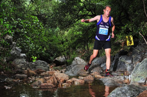 Altus Badenhorst and Leilani Scheffer set the course ablaze in Buffelspoort on Sunday, 22 January 2017 completing the 12km XTERRA Trail Run in 52 minutes 34 seconds and 01 hour 34 seconds respectively.  Seen here:  Altus Badenhorst in action during the 12km XTERRA Trail Run at Buffelspoort Dam.  Photo Credit:  Jetline Action Photo