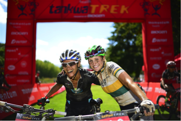 Yolande de Villiers (left) and Mariske Strauss celebrate winning the final stage of the Momemtum Health Tankwa Trek, presented by Biogen on Sunday. Photo credit: www.zcmc.co.za