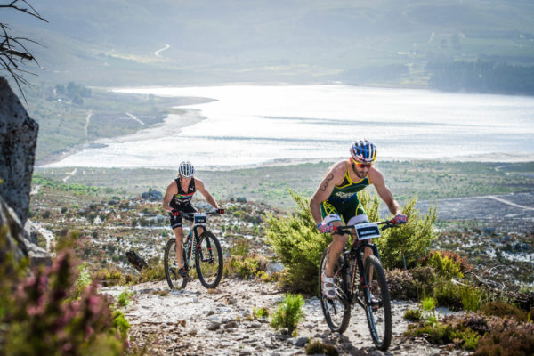 Olympians Richard Murray (South Africa) and Flora Duffy (Bermuda) claimed the coveted men's and women's Champions title at the 2017 Fedhealth XTERRA South African Championship in Grabouw on Saturday, 25 February 2017.  Murray completed the 1.5km swim, 26km MTB, 12.5km trail run in a lightning fast time of 02 hours 22 minutes 46 seconds, while Duffy claimed gold in 02 hours 39 minutes.   Seen here (from left to right):  Bradley Weiss and Richard Murray in action on the day.  Photo Credit:  Tobias Ginsberg