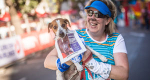 Celebrating its 3rd anniversary in 2017, the organisers of the FNB Cape Town 12 ONERUN are proud to continue supporting two local charities:  Die Burger Kersfonds and The Cape Of Good Hope SPCA.  When entering online, runners can choose to support either or both the FNB Cape Town ONERUN Charities.  Seen here:  A SPCA supporter with her four-legged companion at the 2016 FNB Cape Town 12 ONERUN.  Photo Credit:  Tobias Ginsberg