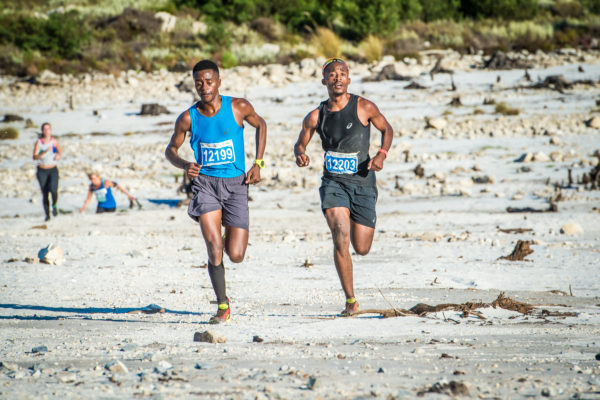 South Africa's trail running enthusiasts were granted the unique opportunity to experience the thrilling XTERRA Vibe on Sunday, 26 February 2017 while taking on only ⅓ of the challenge, the XTERRA Trail Run in Grabouw. Givemore Mudzinganyama and Edwin Sesipi set the pace in the men's 12.5km race.  Both runners crossed the finish line in an impressive time of 46 minutes 33 seconds.  Megan Leslie set the pace in the women's 12.5km XTERRA Trail Run claiming gold in 59 minutes 45 seconds.   Seen here (from left to right):  Givemore Mudzinganyama and Edwin Sesipi in action on the day.  Photo Credit:  Tobias Ginsberg