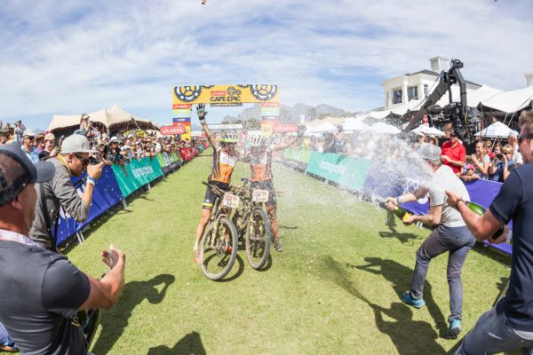Esther Süss and Jenny Stenerhag were doused in Méthode Cap Classique as they crossed the finish line to secure victory in the 2017 Absa Cape Epic. Photo by Dominic Barnardt/Cape Epic/SPORTZPICS.