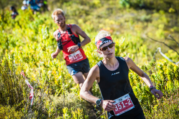 The final stage of the 2017 Cell C AfricanX Trailrun presented by ASICS was met with mixed emotions on Sunday, 19 March 2017.  Excited to finish, but sad to close off the journey, teams of two were bussed to the picturesque Wildekrans Wine Estate for the start of Stage Three.  All that stood between teams and the finish line at the majestic Houw Hoek Inn was 23km of sensational trail running.   Team KWAY Nedbank's AJ Calitz and Nicolette Griffioen also secured their second stage victory and overall mixed team champion title in 01 hour 52 minutes 07 seconds and 07 hours 38 seconds 04 minutes respectively.  Seen here:  AJ Calitz and Nicolette Griffioen in action during Stage Three.  Photo Credit:  Tobias Ginsberg
