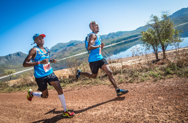 The cream of South Africa's trail running community will be seen in action at the 9th annual Cell C AfricanX Trailrun presented by ASICS in Grabouw this coming weekend, 17 – 19 March 2017.  Seen here (from left to right):  Givemore Mudzinganyama and Edwin Sesipi of Team ASICS in action at the 2016 Cell C AfricanX Trailrun presented by ASICS.  Photo Credit:  Tobias Ginsberg