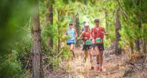 Two of South Africa's leading trail runners, Landie Greyling and Megan Mackenzie will be seen teaming up the weekend of 17 – 19 March 2017 to defend their title at the 9th annual Cell C AfricanX Trailrun presented by ASICS.  Seen here (left to right):  Megan Mackenzie and Landie Greyling in action at the 2016 Cell C AfricanX Trailrun presented by ASICS.  Photo Credit:  Tobias Ginsberg