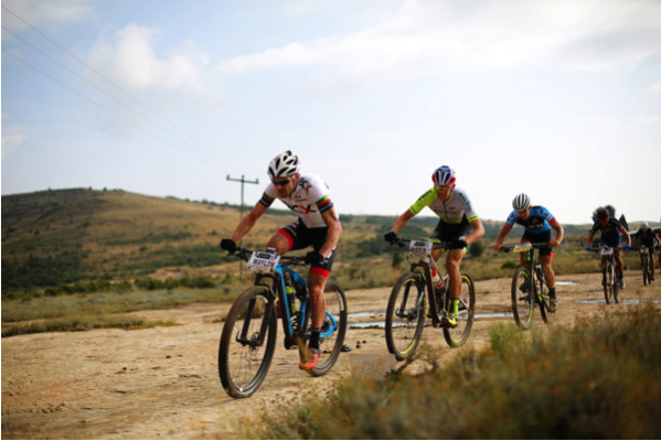 Waylon Woolcock (Team BCX) leads Philip Buys (Pyga Eurosteel) and Arno du Toit (LCB Racing)  over a slick rock section during stage 1 of the Ashburton Investments National MTB Series in Clarens. Photo Credit: www.zcmc.co.za