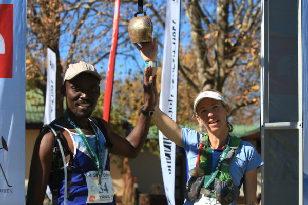 Race winner Thabo Dladla (left) and women's race winner Su Don-Wauchope ring the finishers bell at the end of the final stage of the 2017 Giant's Cup on Saturday 20 May. Greg Labuschagne / Gameplan Media