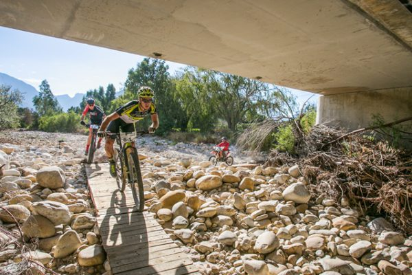 "Erik Kleinhans and Matt Beers (Topeak Ergon/RED-E) were convincing winners on stage 1 of the 2017 Gravel & Grape Extreme MTB, claiming the 67km stage in a time of 2:55:26. The three-day event in the Breedekloof Valley features a mix of rugged, rocky riding and technical single track. Despite the challenging terrain, the winners were delighted with the course layout. ""This was incredible riding,"" said Kleinhans, ""absolutely real mountain biking from start to finish. I loved it."""