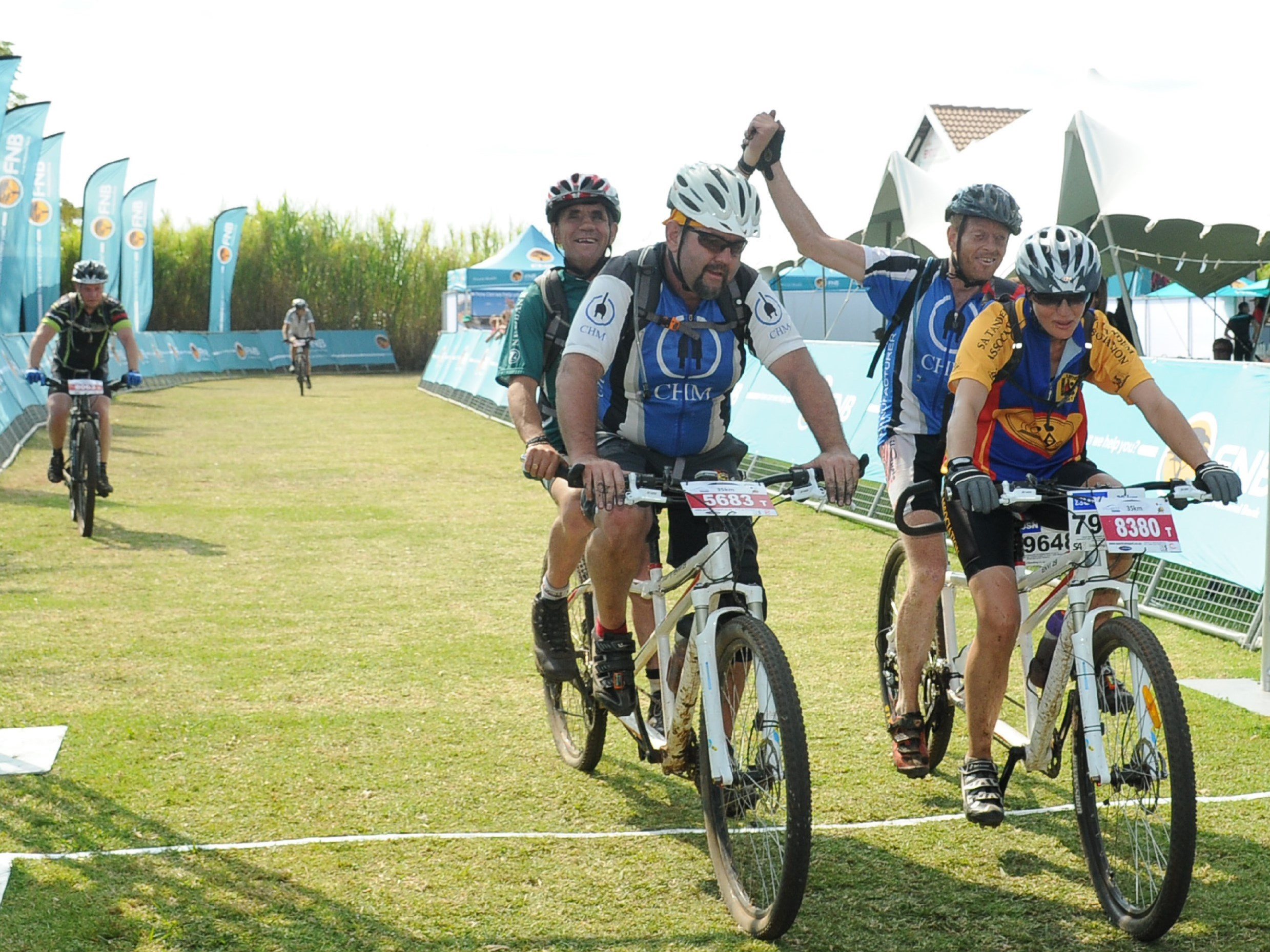 Two eager mountain bikers, Dan Manders and Morne Swanepoel will not allow their competitive spirit to be dampened by their inability to see.  A true inspiration, both riders will attempt to conquer the revered 70km FNB Magalies Monster Mountain Bike Classic on Saturday, 03 June 2017.  Seen here (front left) Theo Coetzee, (back left) Dan Manders, (front right) Cecile Coetzee and (back right) Morne Swanepoel at the 35km FNB Magalies Monster Mountain Bike Classic in 2016.  Photo Credit:  Jetline Action Photo