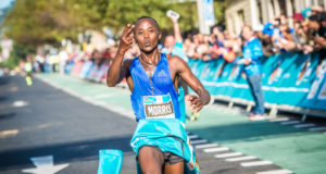 Kenya's 22-year-old Morris Gachaga may be softly spoken, but there is nothing wrong with his legs – and did they do some serious talking at the 2017 FNB Cape Town 12 ONERUN on Sunday 21 May, when the diminutive runner smashed the previous World Best on a point to point course by four seconds. Gachaga crossed the line in 33:27 eclipsing the 33:31 of Sammy Kitwara run at the Bay to Breakers in May, 2009.  Seen here:  Morris Gachaga claiming gold on the day.  Photo Credit:  Tobias Ginsberg