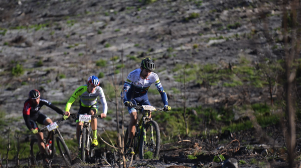 Elite men lead by Gert (Ascendis Health) and followed by Matthys Beukes (Pyga Eurosteel) and Matthew Beers (Red-E Cannondale) at the Nissan TrailSeeker Western Cape Series in Grabouw Photo Credit: www.zcmc.co.za
