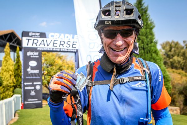 David Purnell poses for a finish line photo after completing the 2017 Glacier Cradle Traverse. Photo by Oakpics.com.