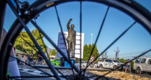 Jayde Julius (left), Nolan Hoffman (centre) and Clint Hendricks pose in front of the statue of Nelson Mandela after a stage of the Bestmed Tour of Good Hope. Photo: Warren Elsom/Capcha Photography
