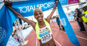 South African middle- and long-distance runner, Mapaseka Makhanya, returned to her winning ways in Durban on Sunday, 16 July 2017 when she showed her competitors a clean pair of heels in the 10km Totalsports Women's Race at the Kings Park Athletics Track.  This year the event encourages entrants to 'Run For Life' in support of PinkDrive, a Non-Profit Company (NPC) that is committed to improving breast cancer awareness, education, and providing and offering free services to the medically uninsured across South Africa.  Seen here:  Mapaseka Makhanya claiming gold at the Totalsports Women's Race in Durban on Sunday, 16 July 2017.  Photo Credit:  Tobias Ginsberg