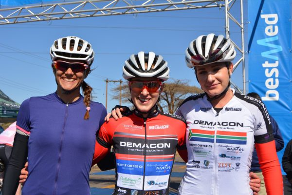 Demacon's Carla Oberholzer (centre) took her maiden title at the Bestmed Cycle4Cansa Championship after winning the 103km road race ahead of Cherise Willeit (left) and teammate Heidi Dalton at Sun City on Sunday. Photo: Full Stop Communications