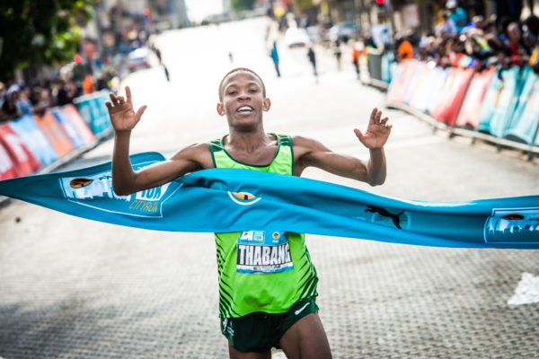 It was expected to be a battle between inform Precious Mashele and SA 10km Record Holder, Stephen Mokoka at the 2nd annual FNB Joburg 10K CITYRUN, but it was Thabang Mosiako who spoiled the party to destroy a quality field on Sunday, 24 September 2017.  Mosiako claimed gold in an impressive time of 29:51.  Glenrose Xaba came into the women's race as the form athlete and did not disappoint crossing the finish line first in 35:39.  Seen here:  Thabang Mosiako claiming gold at the 2017 FNB Joburg 10K CITYRUN.  Photo Credit:  Tobias Ginsberg