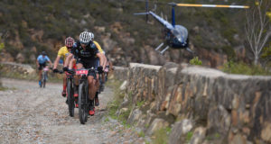 Nico Bell, of NAD Pro MTB, set a ferocious pace up the Montagu Pass in an effort to distance Team Spur/Red-E on stage 5 of the Momentum Health Cape Pioneer Trek, presented by Biogen. Photo by Zoon Cronje.