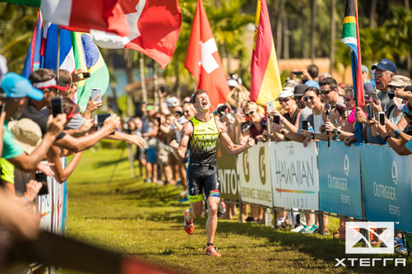 A very happy Weiss crossing the finish line.  Photo Credit:  XTERRA Planet