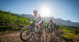 "It was a warm start to Stage One of the 2017 FNB Wines2Whales Mountain Bike (MTB) Ride at the picturesque Lourensford Wine Estate on Monday, 30 October 2017.  The first of two destination stages, Stage One saw riders having to complete a 64km route that featured a 1650m ascent before crossing the finish line at Oak Valley Wine Estate (Elgin-Grabouw), their home away from home.  Olympian Phetetso Monese (Lesotho) and Leonhard Lukoschek (Germany) of Team ACE Lesotho applied pressure from the start.  ""This is my third W2W,"" says Monese.  ""Last year I finished first in the men's race.  I really want to defend my title.  So we went fast from the start.  Stage One featured some great riding.  I was a little worried when I heard that Leonhard was a roadie, but after today I'm no longer worried.""  Seen here:  Team ACE Lesotho's Leonhard Lukoschek and Phetetso Monese leading the field during Stage One of the FNB Wines2Whales MTB Ride.  Photo Credit:  Tobias Ginsberg"
