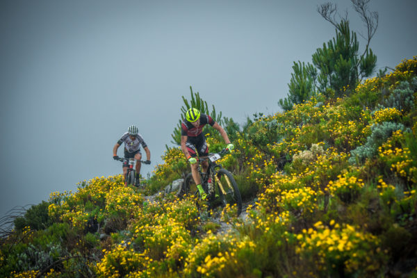 Konny Looser and Christoph Sauser of Team Investec-Songo.info in action during Stage One of the FNB W2W MTB Race.  Photo Credit:  Tobias Ginsberg