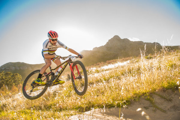 "Men's cross-country World Champion and UCI World Cup Champion Nino Schurter joined in on the action at the 2017 BUCO Origin Of Trails.  ""I love Stellenbosch, it's one of my favorite places to ride,"" says Schurter.  ""The race was cool.  It showed off the really nice trails.  I wasn't in race mode, so I got to see the scenery today.  I took a lot of selfies on the bike and had some really good chats.""  Seen here:  Nino Schurter having fun on route during Stage Two.  Photo Credit:  Tobias Ginsberg"