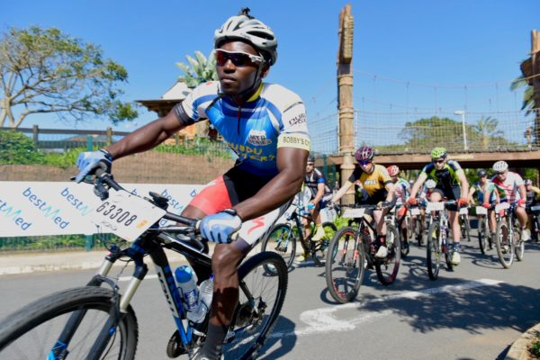 Winner Lindani Shusha, of Port Shepstone, leads the bunch at the start of the 40km race in the Bestmed Wild Coast Sun MTB Classic near Port Edward in KwaZulu-Natal today. Photo: Julian Carelsen