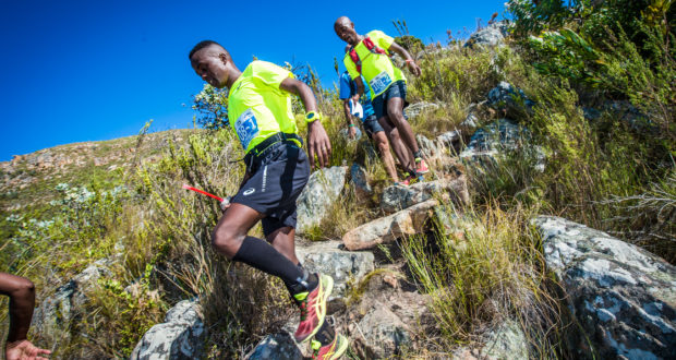 Seen here (from left to right):  Givemore Mudzinganyama and Edwin Sesipi in action during the 2017 AfricanX Trailrun presented by ASICS.  Photo Credit:  Tobias Ginsberg