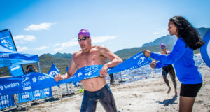 Considered one of the fastest professional open water swimmers in the world, Chad Ho is hoping for a successful title defense on Sunday, 18 February 2018 when he takes on the 4th annual Sanlam Cape Mile brought to you by Sanlam Investments at the picturesque Eikenhof Dam (Elgin, Grabouw).  Seen here:  Chad Ho claims gold at the 2017 Sanlam Cape Mile brought to you by Sanlam Investments.  Photo Credit:  Tobias Ginsberg